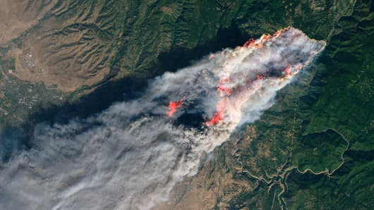 NASA's Operational Land Imager satellite image shows the Camp Fire burning at around 10:45 a.m. local time near Paradise, California, U.S., on November 8, 2018.