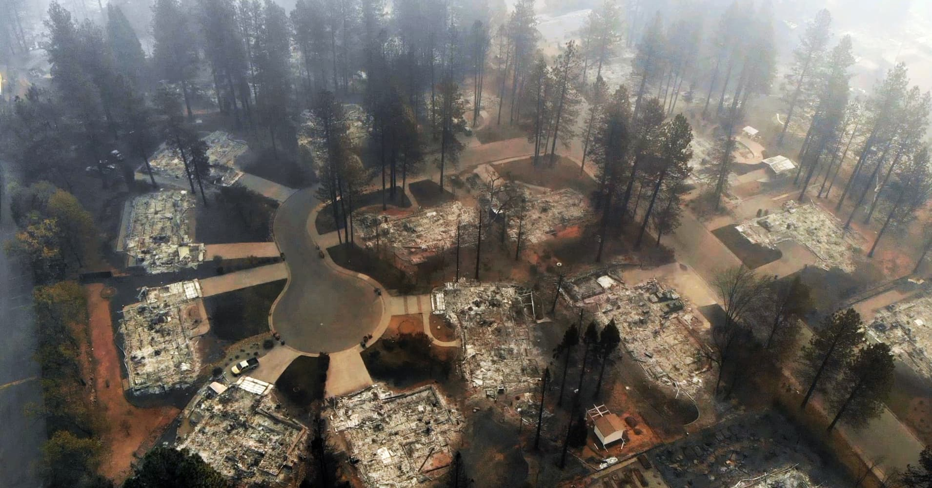 Death toll rises and more than 500 still missing, as rains douse California wildfire