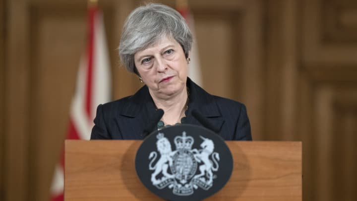 Theresa May, U.K. prime minister, listens to a question from reporters as she delivers a statement on the Brexit agreement during a news conference inside number 10 Downing Street in London, U.K., on Thursday, Nov. 15, 2018.