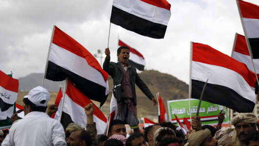 Yemeni supporters of the Houthi movement chant slogans during a rally to mark two years of the military intervention by the Saudi-led coalition, in the capital Sanaa on March 26, 2017.