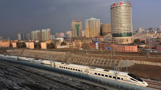 A CRH high-speed train runs across Urumqi city during its test run on November 11, 2014 in Urumqi, Xinjiang.