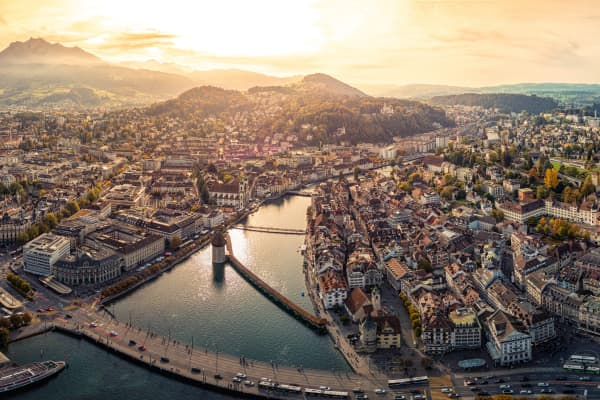 Panoramic photo of Chapel bridge and Reuss River in the city of Lucerne, Switzerland.