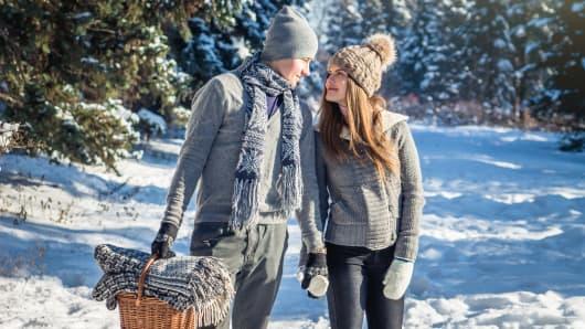 Couple in love walks in winter forest