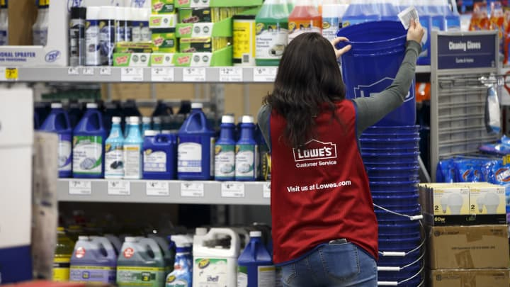 An employee organizes buckets for sale inside a Lowe's Cos. store in Burbank, California.