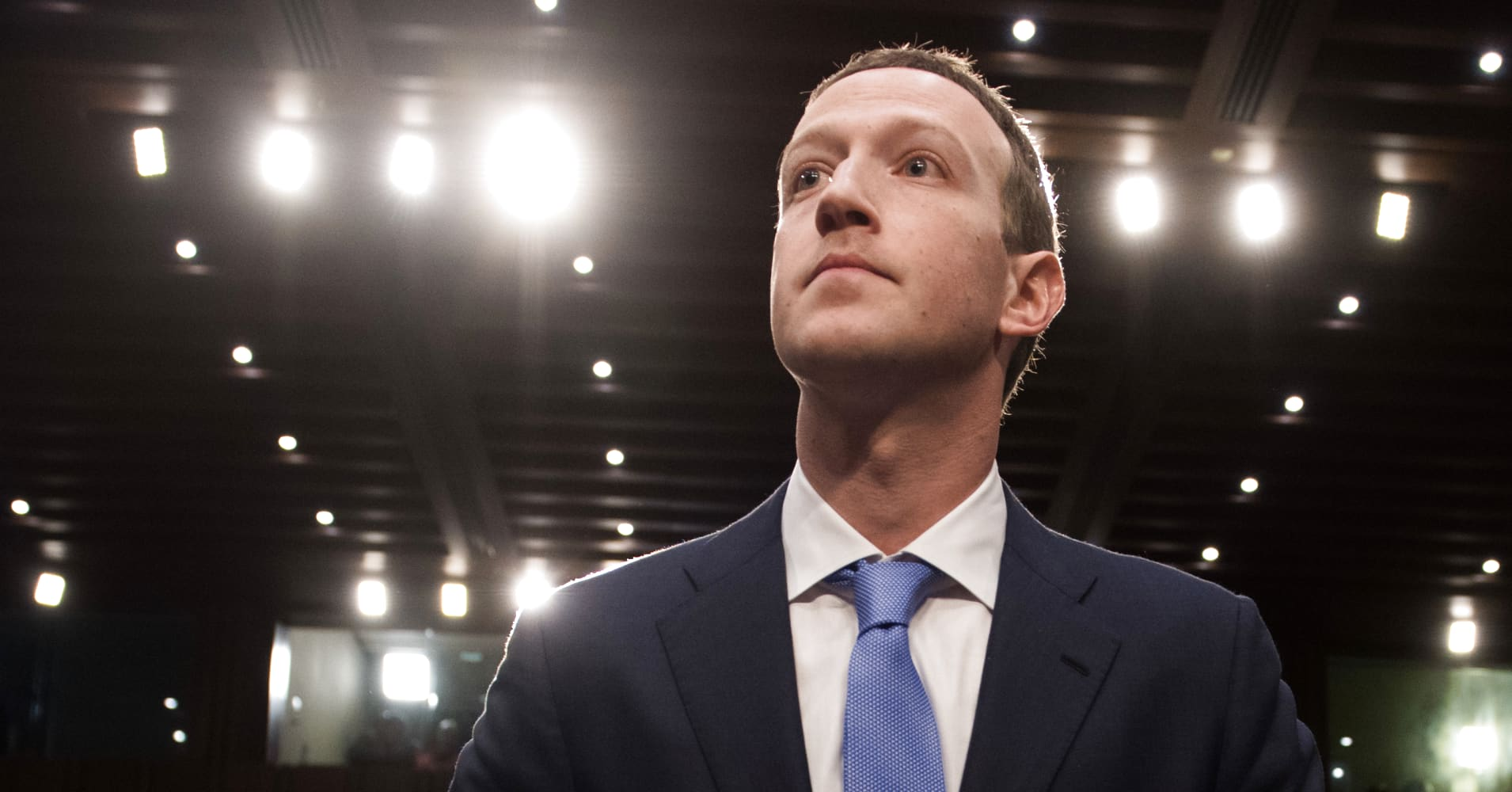 Facebook founder and CEO Mark Zuckerberg arrives to testify following a break during a Senate Commerce, Science and Transportation Committee and Senate Judiciary Committee joint hearing about Facebook on Capitol Hill in Washington, DC.