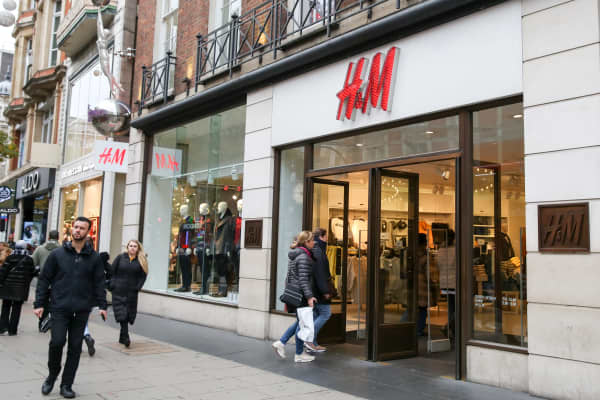 Shoppers are seen outside H&M store on London's Oxford Street.
