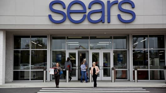 Shoppers exit a newly renovated Sears Holdings Corp. store in Oak Brook, Illinois.