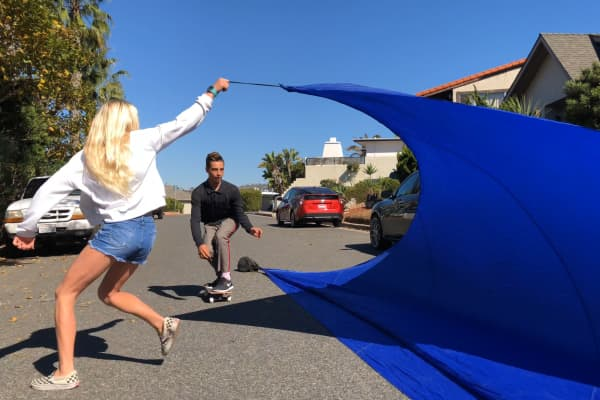 Carson Kropfl passes through his invention Streetubez, a tarp you can skate through like a wave.