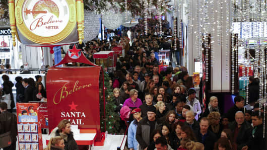 Customers stream into Macy's flagship store in Herald Square on Thanksgiving evening for early Black Friday sales in New York City.