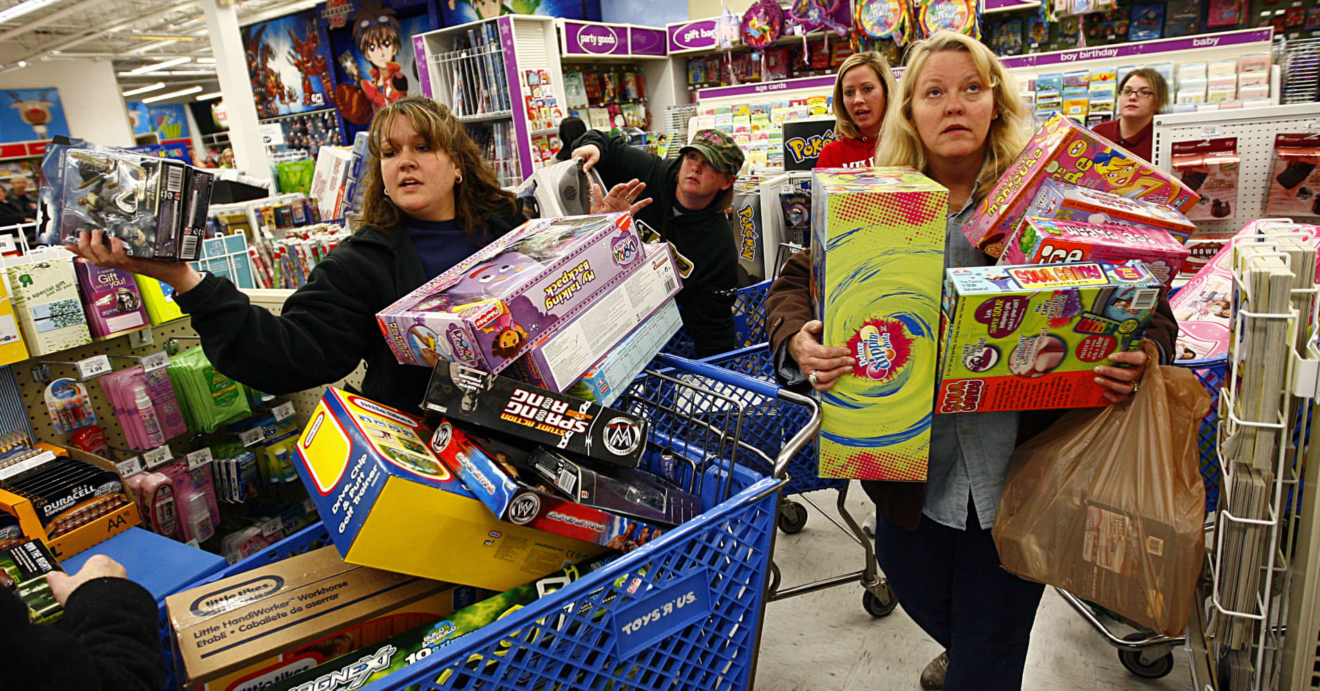 Shoppers wait in line while shopping at Toys'R'Us during the Black Friday sales event on November 27, 2009 in Fort Worth, Texas