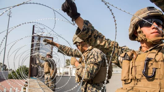 U.S. Marines place concertina wire at the Otay Mesa Port of Entry in California on Nov. 11, 2018.