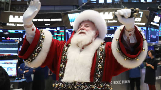 Santa Claus pays a visit on the floor at the New York Stock Exchange, November 21, 2018.