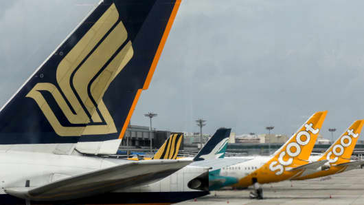 Civil jet airplanes of Singapore Airlines and its subsidiaries — Tigerair, Silkair and Scoot — at Changi International Airport, Singapore.