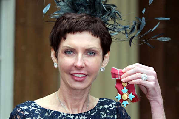 Bet365 Chief Executive Denise Coates poses with her Commander of the British Empire (CBE) medal