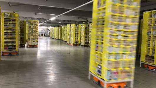 Robots operate at the Tilbury Amazon fulfillment center in the U.K. on Black Friday.