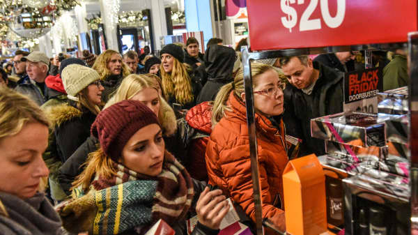 People shop during a Black Friday sales event at Macy's flagship store on 34th St. in New York City, November 22, 2018.