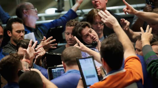 Traders signal offers in the S&P options pit at the Cboe Global Markets exchange.