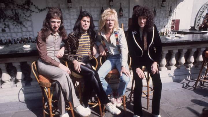 eighth September 1976:  British rock team Queen at Les Ambassadeurs, where they were introduced with silver, gold and platinum discs for gross sales in extra of a million of their hit single 'Bohemian Rhapsody'. The band are, from left to honest, John Deacon, Freddie Mercury (Frederick Bulsara, 1946 - 1991), Roger Taylor and Brian Would per chance maybe well.