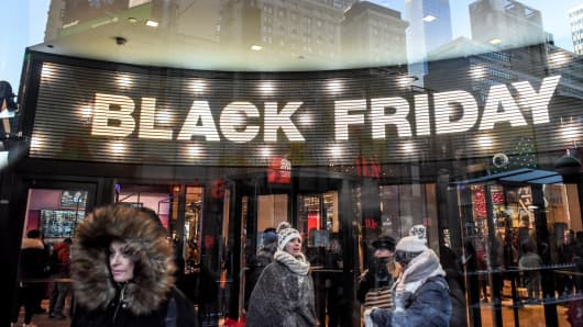 People shop at the Macy's flagship store on 34th St. on Black Friday on November 23, 2018 in New York City.