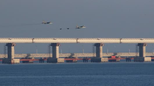 Russian jet fighters fly over a bridge connecting the Russian mainland with the Crimean Peninsula after three Ukrainian navy vessels were stopped by Russia from entering the Sea of Azov via the Kerch Strait in the Black Sea, Crimea November 25, 2018.