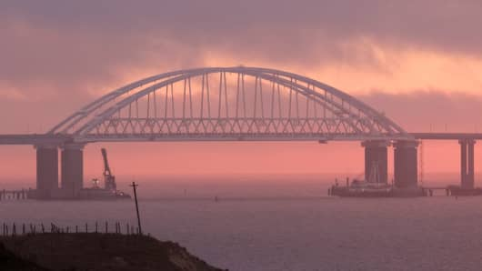 A general view shows a road-and-rail bridge, which is constructed to connect the Russian mainland with the Crimean peninsula, at sunrise in the Kerch Strait, Crimea November 26, 2018.