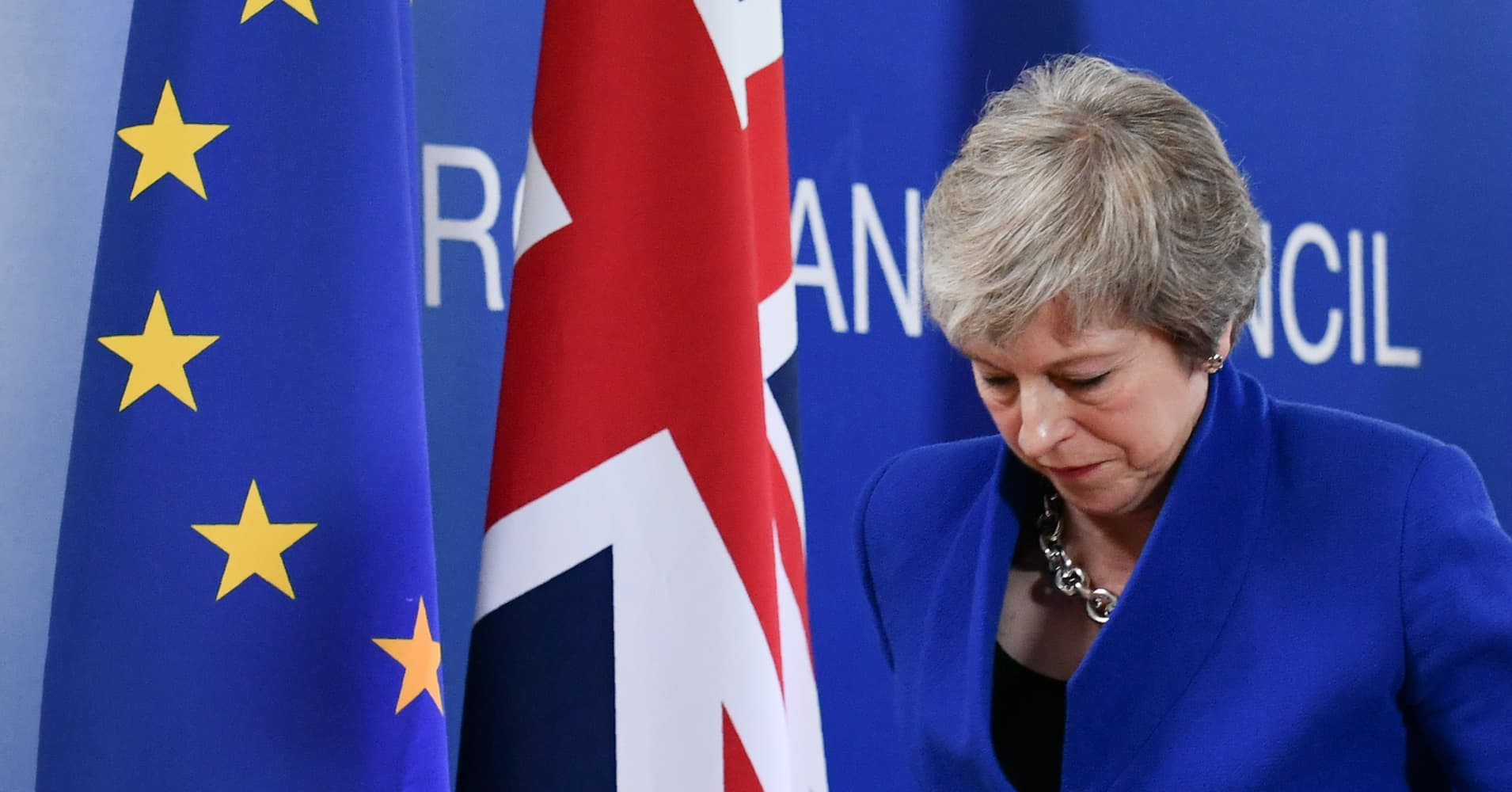 European markets climb higher; British PM set to face leadership challenge; Colruyt shares jump 8%