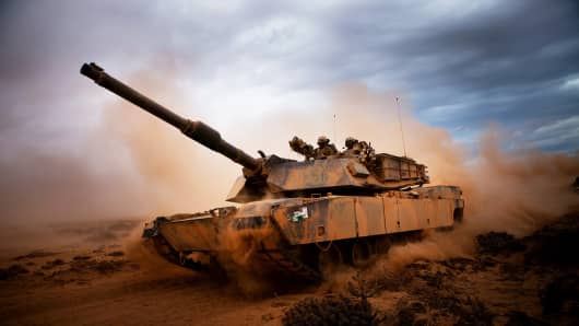 Marines from 4th Tank Battalion, Twentynine Palms, Calif., roll down a dirt road on their M1A1 Abrams Main Battle Tank during a day of training.