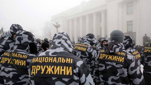 Members of the National Militia rally for the termination of the 2003 agreement between Ukraine and Russia on the Sea of Azov outside the Verkhovna Rada building, Kyiv, capital of Ukraine, November 26, 2018. In 2003, the two countries signed the treaty, which defined the Sea of Azov as internal waters and guaranteed free navigation to all Ukrainian and Russian ships.