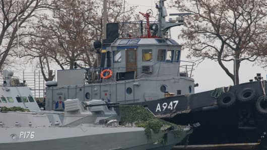 Seized Ukrainian military vessels are seen in a port of Kerch, Crimea, on November 26, 2018. - Kiev and Moscow faced their worst crisis in years on November 26, 2018 as Ukraine and its Western allies demanded the release of three ships fired on and seized by Russia near Crimea. Russian forces boarded and captured the ships on Sunday, with Moscow accusing the vessels of illegally entering Russian waters off the coast of Crimea in the Sea of Azov.