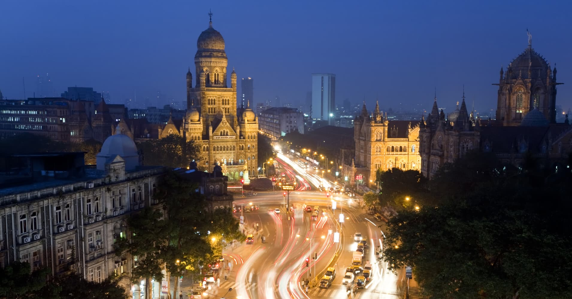 View over Victoria terminus or Chhatrapati Shivaji terminus and central Mumbai at dusk Mumbai India