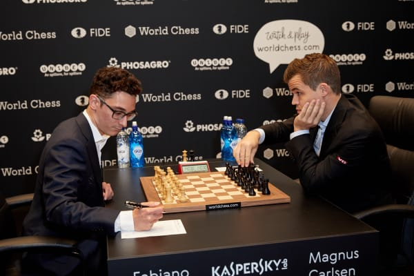 Magnus Carlsen, the reigning World Chess Champion (R) and Fabiano Caruana, US Challenger during the First Move Ceremony (Round 1) of the FIDE World Chess Championship Match 2018 on November 9, 2018 in London, England.