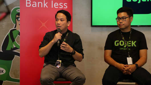 Go-Jek's president Andre Soelistyo (left) and Go-Jek's global head of transport, Raditya Wibowo speak at the company's press conference for its beta launch in Singapore