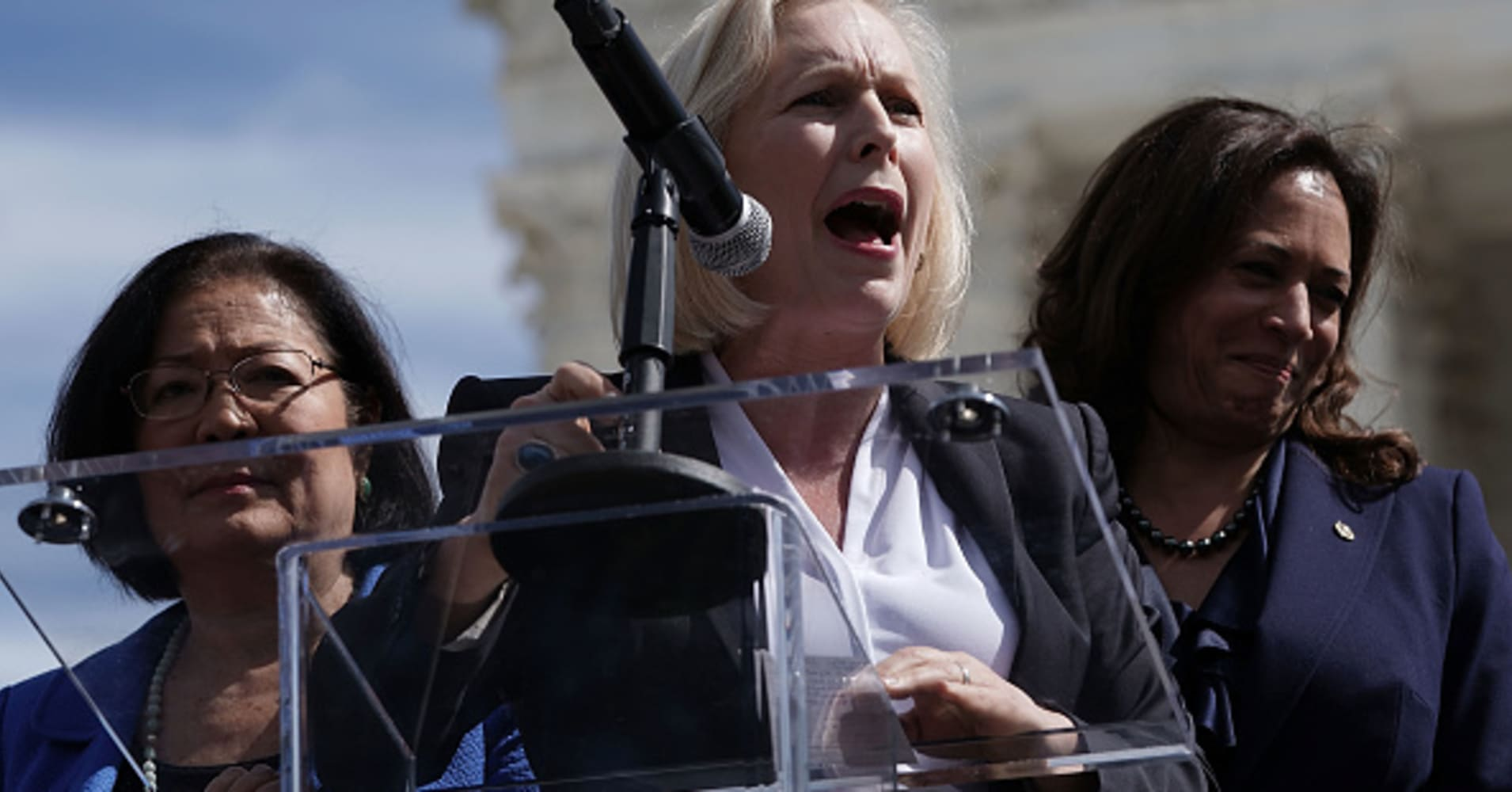 U.S. Sen. Kirsten Gillibrand (D-NY) speaks as Sen. Mazie Hirono (D-HI) (L) and Sen. Kamala Harris (D-CA) listen during a rally in front of the U.S. Supreme Court September 28, 2018 in Washington, DC.