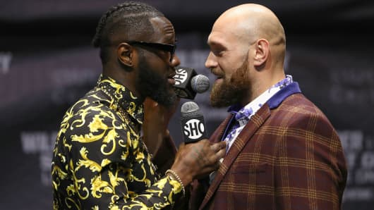Professional boxers Deontay Wilder (L) and Tyson Fury speak on stage during a press conference to promote their upcoming fight on December 1, 2018 in Los Angeles at Microsoft's The Novo on October 3, 2018 in Los Angeles , California.