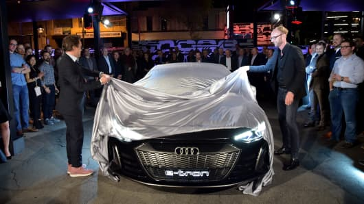 Robert Downey Jr. (L) and Head of Design of Audi AG, Marc Lichte attend the global reveal of the Audi e-tron GT concept on November 26, 2018 in Los Angeles, California.