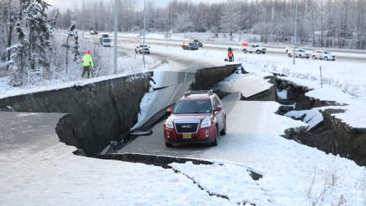 A vehicle lies stranded on a collapsed roadway near the airport after an earthquake in Anchorage, Alaska, U.S. November 30, 2018.