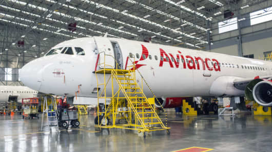 An airplane sits at the Avianca Holdings SA Maintenance, Repair and Overhaul (MRO) Aeronautical Center in Rionegro, Colombia on Tuesday, Nov. 7, 2017. Avianca Holdings SA reported a net income of $36.1 million USD in the third quarter despite a pilot strike that lasted for almost two months.