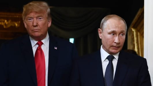 US President Donald Trump and Russian President Vladimir Putin arrive for a meeting in Helsinki, on July 16, 2018.