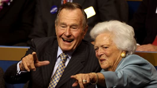 Former President George H.W. Bush and former first lady Barbara Bush point from their seats on Day 2 of the Republican National Convention at the Xcel Energy Center on September 2, 2008 in St. Paul, Minnesota.
