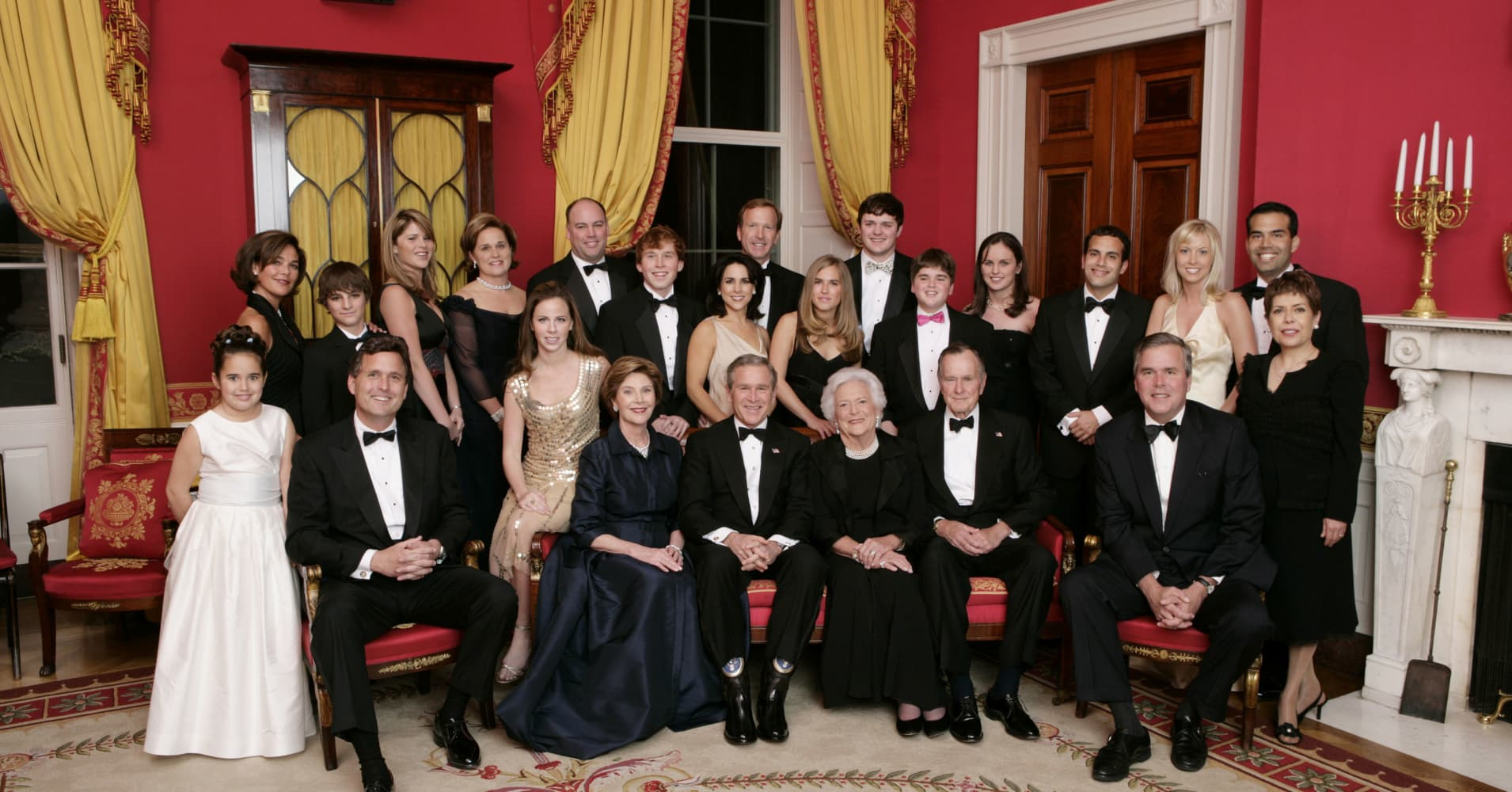Then-President George W. Bush, first lady Laura Bush, former first lady Barbara Bush and former President George H.W. Bush sit surrounded by family in the Red Room of the White House, January 6, 2005, in Washington. Friends and family joined former President Bush and Barbara Bush in celebrating their 60th wedding anniversary at a dinner. Also pictured are:  (L to R) Georgia Grace Koch, Margaret Bush, Walker Bush, Marvin Bush, Jenna Bush, Doro Koch, Barbara Bush, Robert P. Koch, Pierce M. Bush, Maria Bush, Neil Bush, Ashley Bush, Sam LeBlond, Robert Koch, Nancy Ellis LeBlond, John Ellis Bush Jr., Florida Gov. John Ellis 'Jeb' Bush, Mandi Bush, George P. Bush, and Columba Bush.  (Photo by Eric Draper/White House via Getty Images)