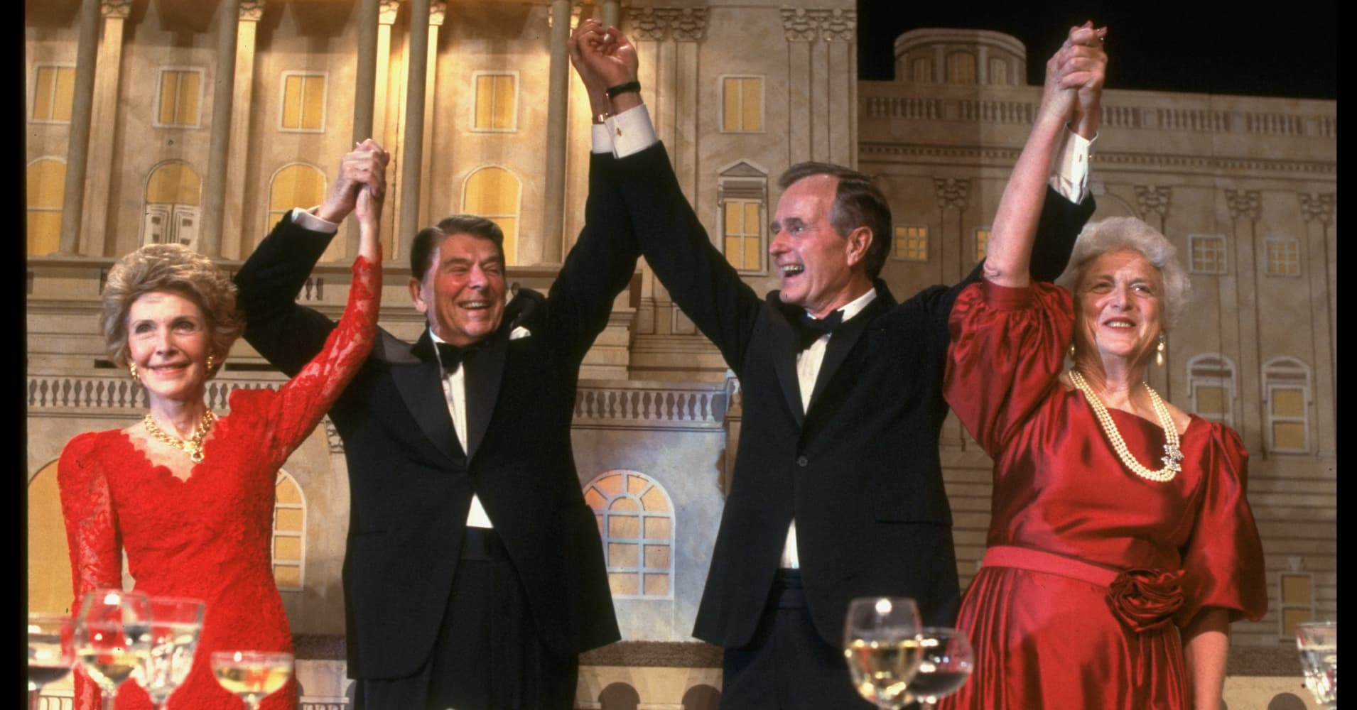 Vice President and Barbara Bush (R) with President and Nancy Reagan as Reagan endorses Bush's presidential candidacy at a dinner.