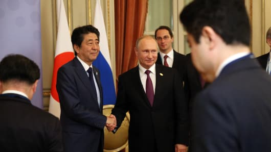 BUENOS AIRES, ARGENTINA - DECEMBER 1: (RUSSIA OUT) Russian President Vladimir Putin (R)  shakes hands with Japanese Prime Minister Shinzo Abe (L) during their bilateral meeting at the G20 Summit in Buenos Aires, Argentina, December 1, 2018. U.S. President Donald Trump has cancelled his meeting with Vladimir Putin at the G20 Summit in Argentina planned on Saturday.