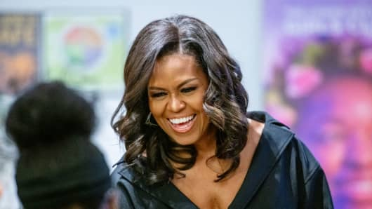 Former first lady Michelle Obama visits The Lower Eastside Girls Club to meet and greet the members and discuss her new book 'Becoming' on December 01, 2018 in New York City.
