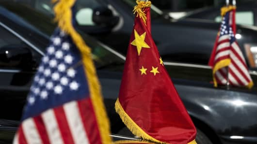 US and Chinese national flags are seen on the motorcade of US Vice President Joe Biden during his meeting with Chinese Premier Wen Jiabao during their meeting at the Zhongnanhai leaders' compound in Beijing on August 19, 2011.