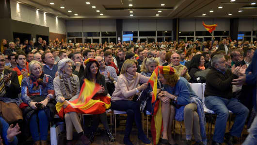People attend a campaign meeting of Spain's far-right party VOX on November 26, 2018 in Granada. With a tough line on immigration and Catalan separatism, Spain's tiny far-right party VOX is starting to make waves.