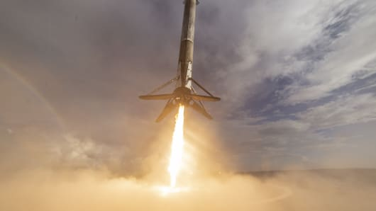 SpaceX lands a Falcon 9 rocket on the company's autonomous barge after a successful launch.