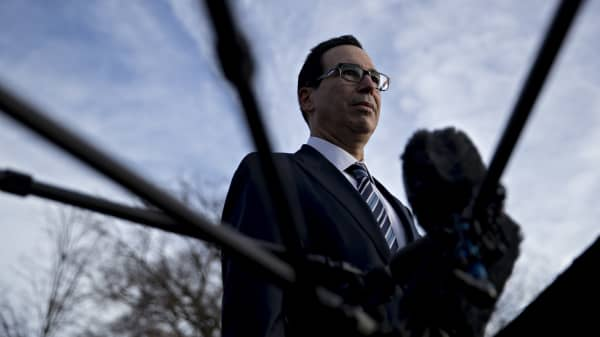 Steven Mnuchin, U.S. Treasury secretary, listens to a question while speaking to members of the media outside the White House in Washington, D.C., U.S., on Monday, Dec. 3, 2018.