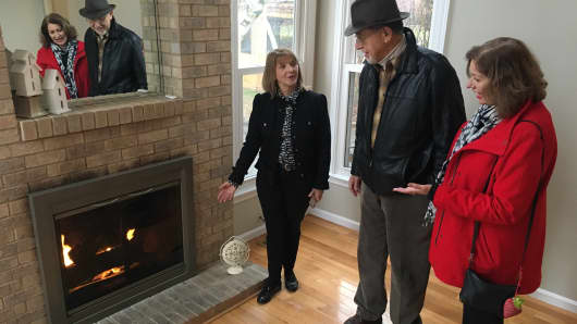 Real estate agent Lynn Fairfield, with RE/MAX Suburban, shows a home in a Chicago suburb.