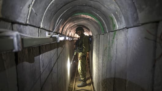 An Israeli army officer walks on July 25, 2014 during an army-organised tour in a tunnel said to be used by Palestinian militants from the Gaza Strip for cross-border attacks. Israel launched its military offensive aiming at destroying tunnels used by Gaza militants.