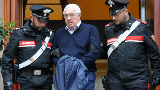 Settimo Mineo is escorted by police as he exits a police station after his arrest in Palermo on December 4, 2018.